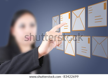 Asian business lady pushing mail for social network.