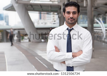 asian business man crossing arm; portrait of Asian, north indian successful and confident businessman