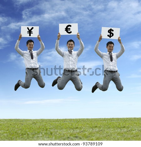 Asian business man jumping with currency symbols saying 'YES'