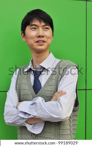 asian business man leaning against the wall