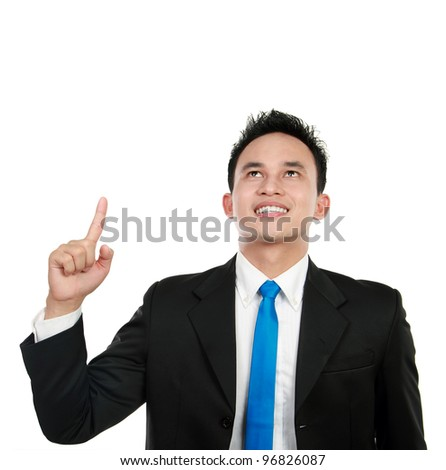 asian business man look up and pointing his finger to blank copy space studio isolated on white background