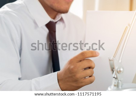 Asian Business man Manager checking and signing applicant filling documents reports papers company application form or registering claim on desk office. Document Report and business busy Concept #1117571195