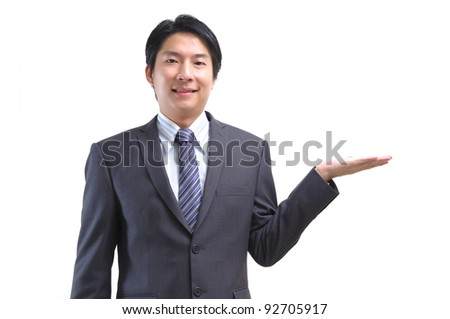 Asian business man standing with open hand isolated on white