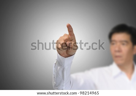 asian Business Man Touch on gradient grey background