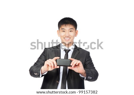 Asian Business man use communicator camera taking picture, with camera phone, handsome young businessman smile hold touch screen cell phone, isolated over white background