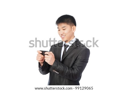 Asian Business man use communicator, reading a text message and smiling, handsome young businessman smile looking to touch screen cell phone, wear elegant suit and tie isolated over white background