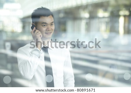Asian Business man using a Cell Phone