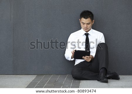 Asian Business man using a touch pad