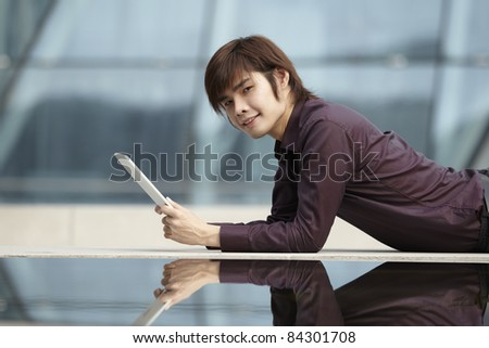Asian Business man using a  touch pad PC