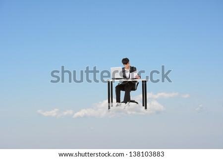 Asian business man work at cloud, cloud concept for business, creative, technology, social network etc.