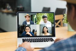 Asian business people video conference online on laptop. Meeting businessman and woman discussion corporate work from home.