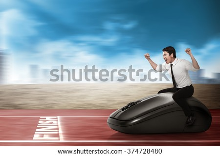 Asian business person riding computer mouse. Business technology concept #374728480