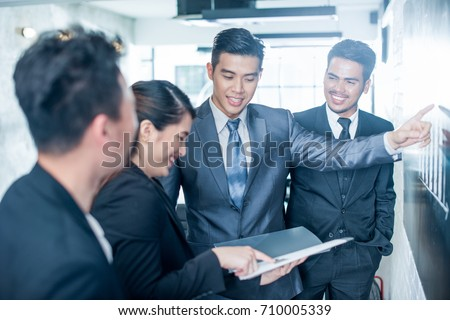 asian business team. image with ...