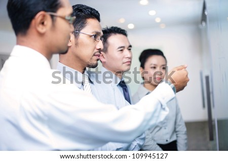 Asian business Team In Meeting - stock photo