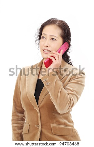 Asian business woman calling by cellular phone