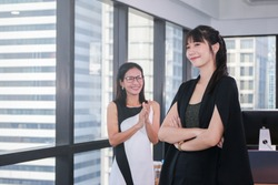 Asian business woman clapping and admire to young leader for success project