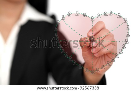 Asian business woman drawing Social Network in Love Concept (selective focus) - stock photo