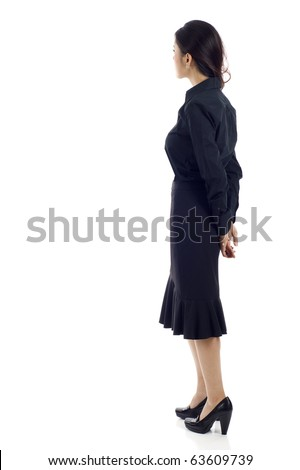 Asian business woman from the back - looking at something over a white background - stock photo