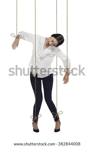Asian business woman have string attached to her body. Marionette doll concept