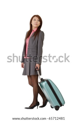 Asian business woman holding suitcase to travel isolated over white.