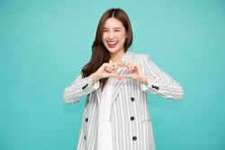Asian business woman in suit showing heart sign isolated on white background, Speading love and happiness concept