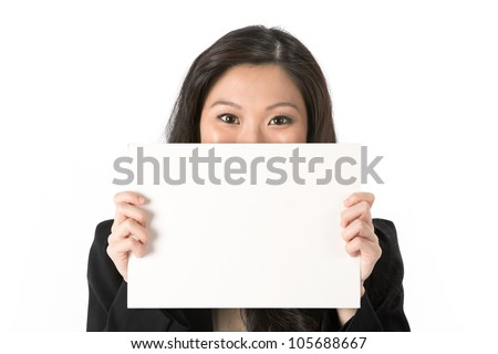 Asian Business woman looking over an empty white sign.