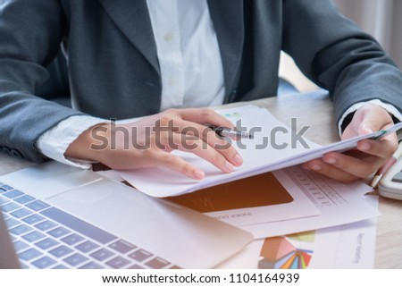 Asian Business woman Manager checking and signing applicant filling documents reports papers company application form or registering claim on desk office. Document Report and business busy Concept #1104164939