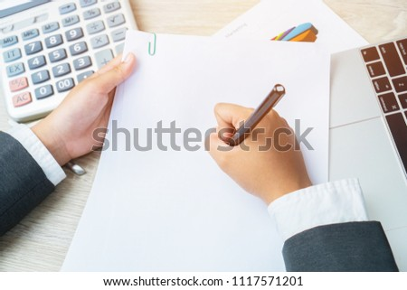 Asian Business woman Manager checking and signing applicant filling documents reports papers company application form or registering claim on desk office. Document Report and business busy Concept #1117571201
