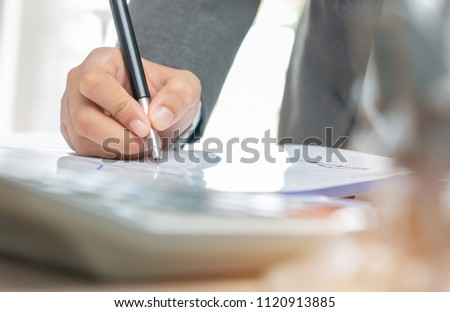 Asian Business woman Manager checking and signing applicant filling documents reports papers company application form or registering claim on desk office. Document Report and business busy Concept #1120913885