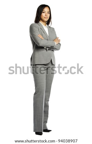 Asian business woman serious with crossed arms against white background