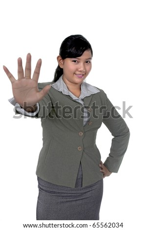 Asian business woman show hand gesture to stop isolated over white background