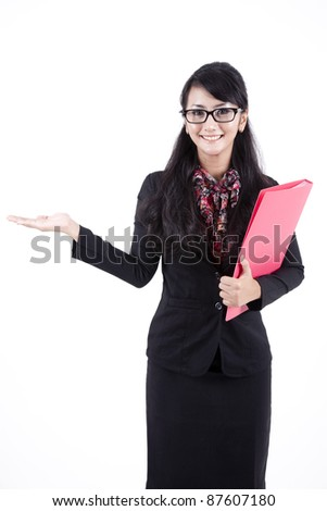 Asian business woman showing copy-space. Presentation. Isolated over white background.