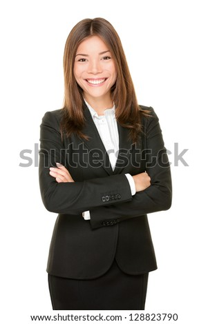 Asian business woman smiling happy portrait in black suit standing proud and confident with arms crossed isolated on white background. Young mixed Asian Chinese / Caucasian professional businesswoman