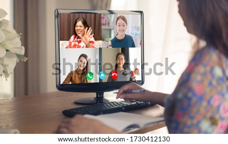 Asian business woman talking to her colleagues about plan in video conference.Online meeting in video call.Online work from home.Stay home for save lives.Technology, Healthcare, People meeting online.