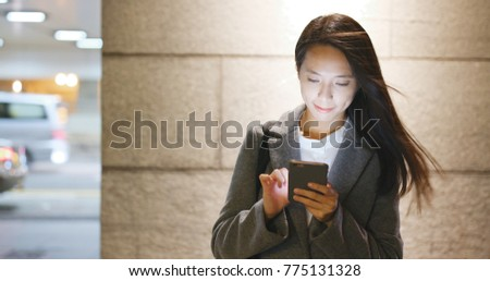Asian business woman use of mobile phone at night