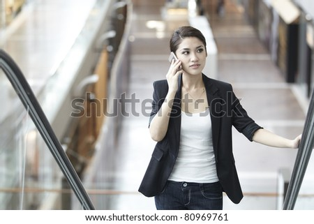 Asian Business woman using a Cell Phone