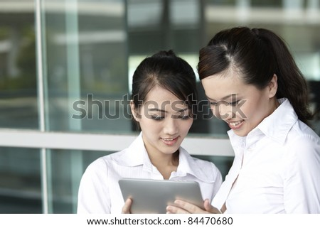 Asian  Business woman using a Digital Tablet