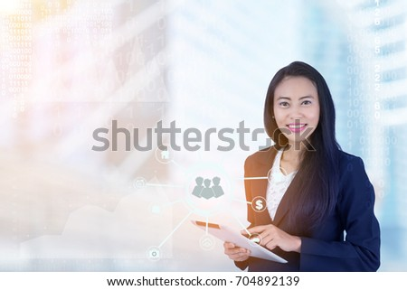 Asian Business woman using a tablet and background blur office. Using only modern technology will help ensure that customers receive comprehensive solutions. And better support as soon as possible.