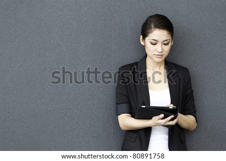 Asian Business woman using a touch pad
