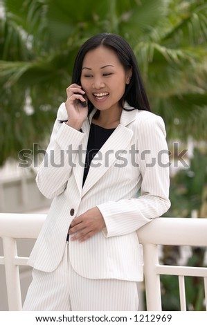 Asian Business Woman with Cell Phone Laughing