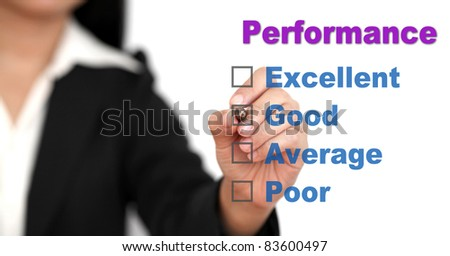 Asian business woman writing on performance audit checklist