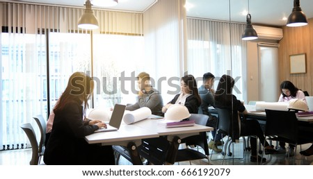 Asian business women and group using notebook for meeting and business women smiling happy for working  #666192079