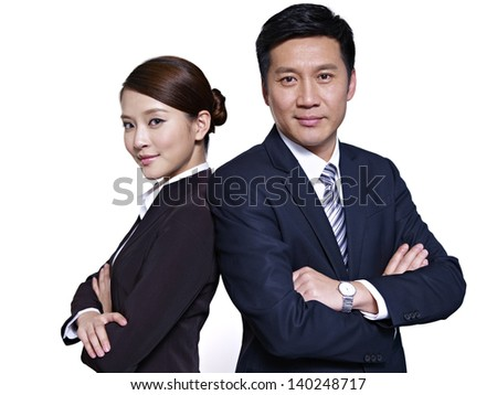 asian businessman and businesswoman standing back to back, arms crossed