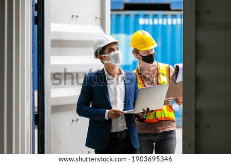 Asian businessman and Professional foreman woman work at Container cargo site check up premium goods in container, business Logistics oversea import export shipping industrial import-export transport. Foto stock ©