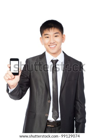 Asian businessman displaying mobile phone happy smile looking at camera, isolated touch screen on white background