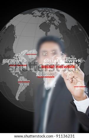 Asian businessman draw social network world map.
