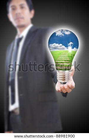 Asian businessman giving bulb for nature.