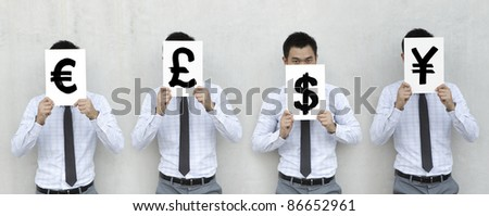 Asian Businessman holding signs with currency symbols