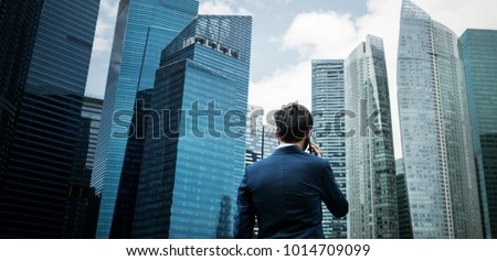 Asian businessman in a city #1014709099