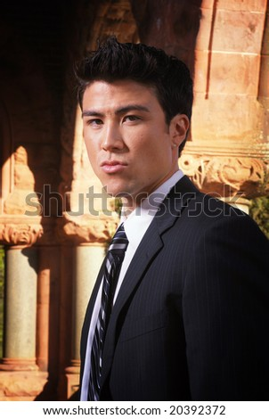 Asian businessman in front of old columns